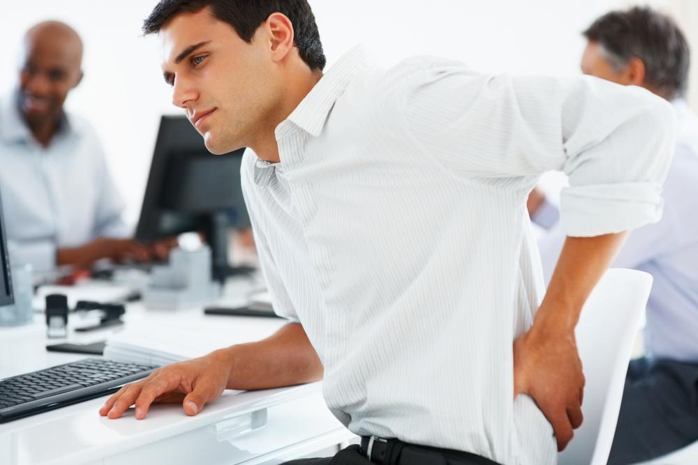 man with lower back pain at offce